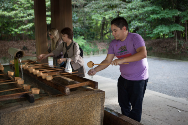 Andrew doing a hand-washing ritual at a Shinto temple