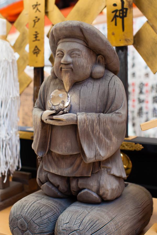 Rub the buddha for good luck