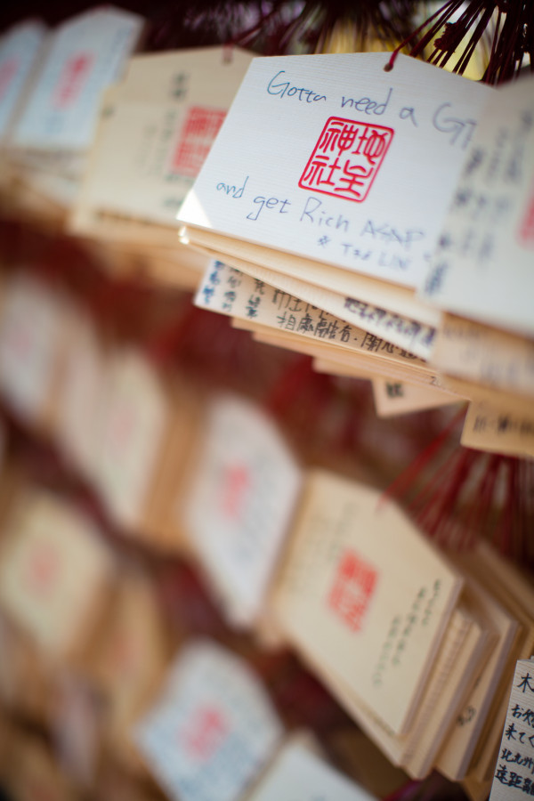 """The best wish in the bunch...""""gotta need a girlfriend and get rich ASAP."""" Depending on the girl, he/she may have those in the wrong order :) You can buy these wooden plaques and write your wishes on them. Once a month the temple burns them so your wish comes true."""